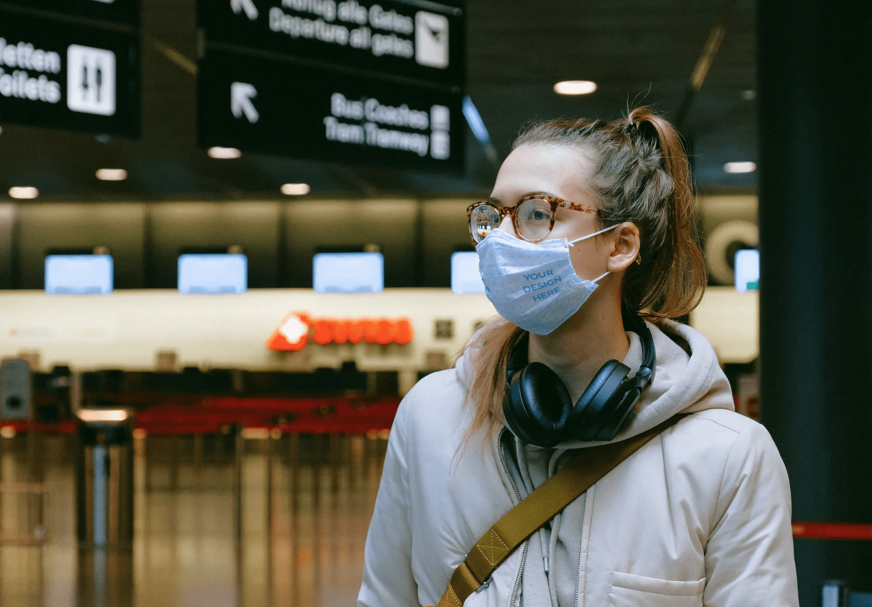 Woman Wearing a Face Mask at the Airport Free Mockup Generator