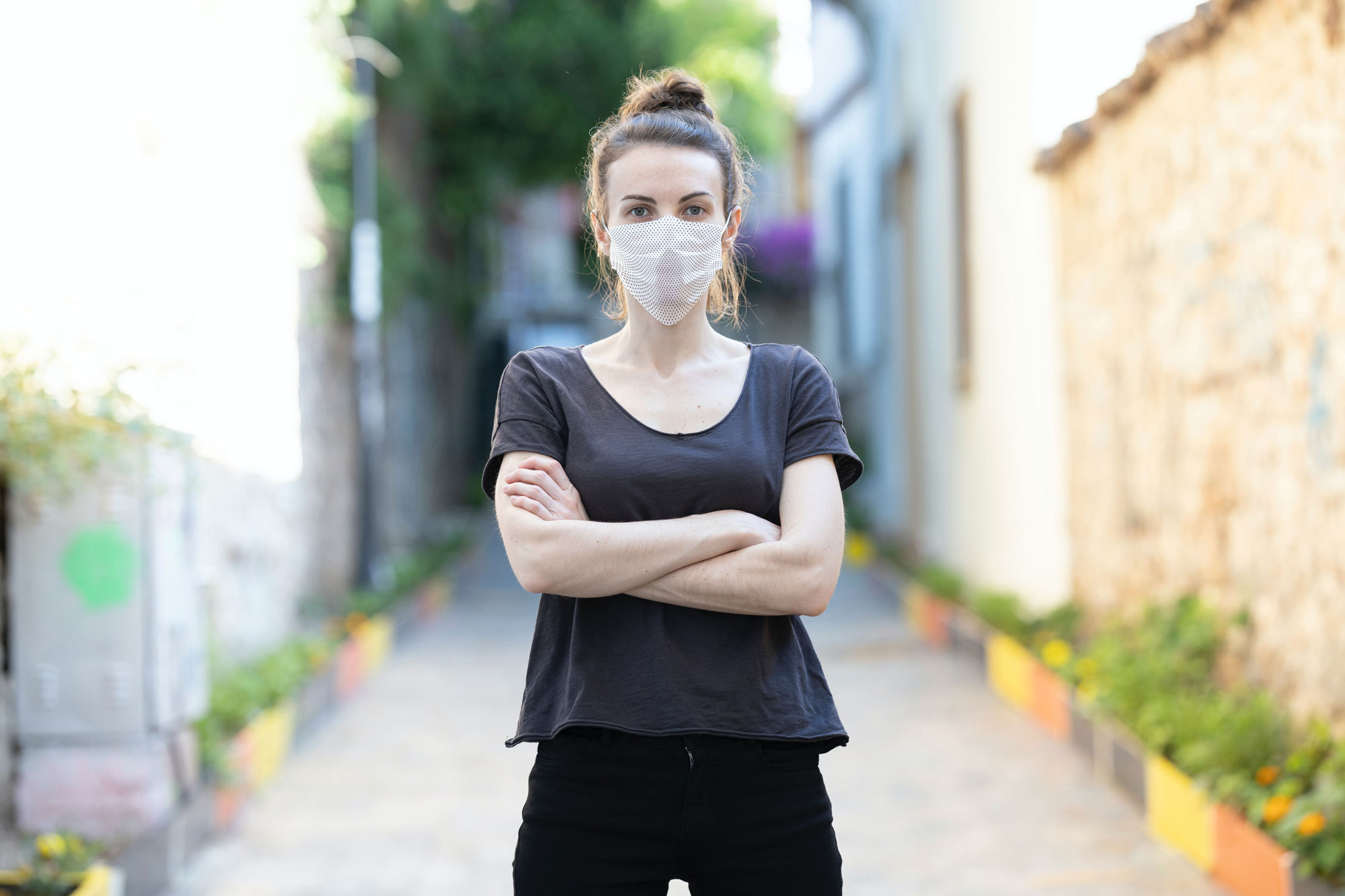 Young Woman Wearing a Face Mask Mockup with a Pattern