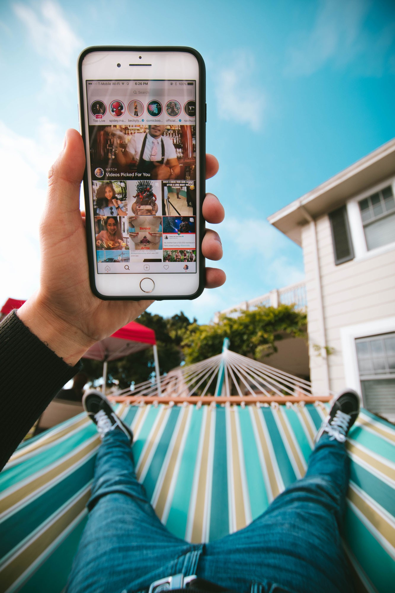 iPhone in the Hand of a Guy in a Hammock Free PSD Mockup Preview Instagram