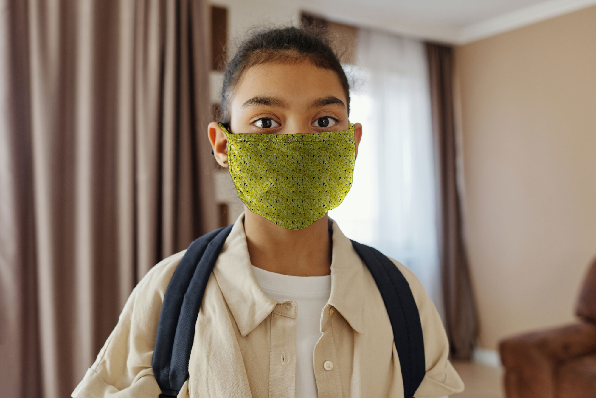 Little Girl Wearing a Face Mask Mockup