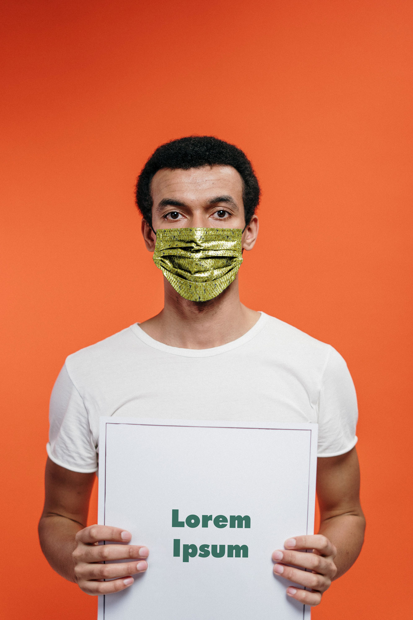 Man in a Face Mask Holding the Poster Mockup