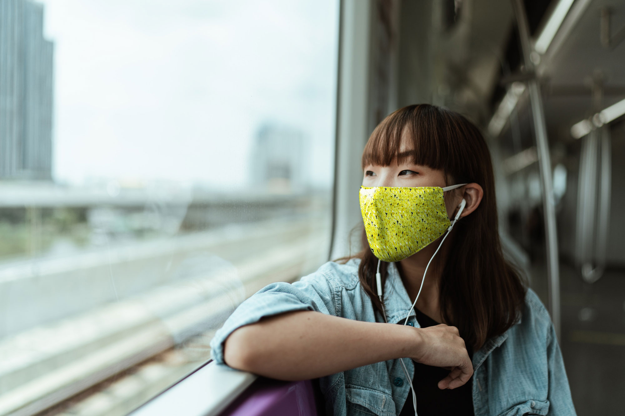 mask mockup woman in train wearing face mask