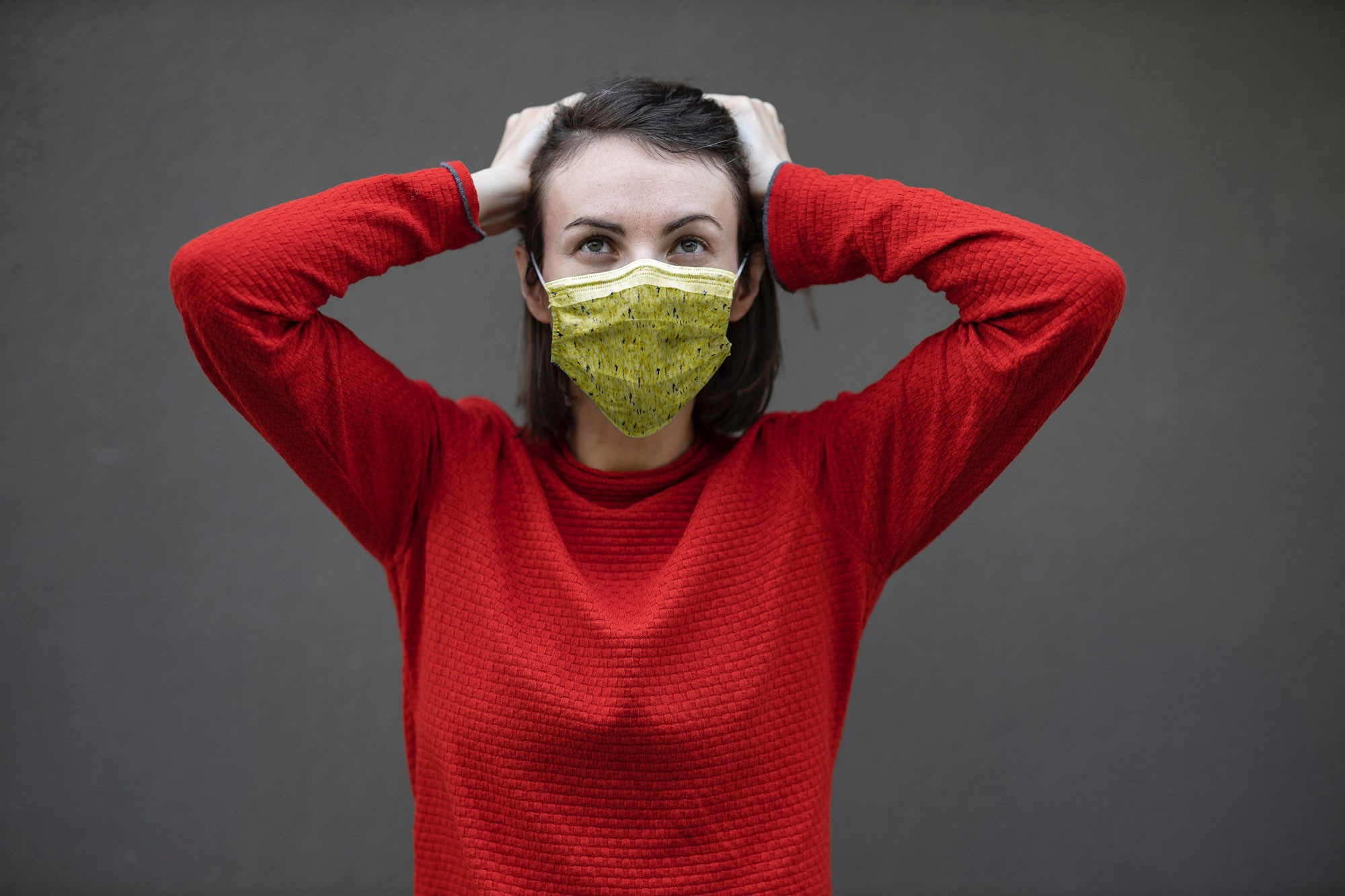 Mask Mockup With Young Woman in Red Sweater