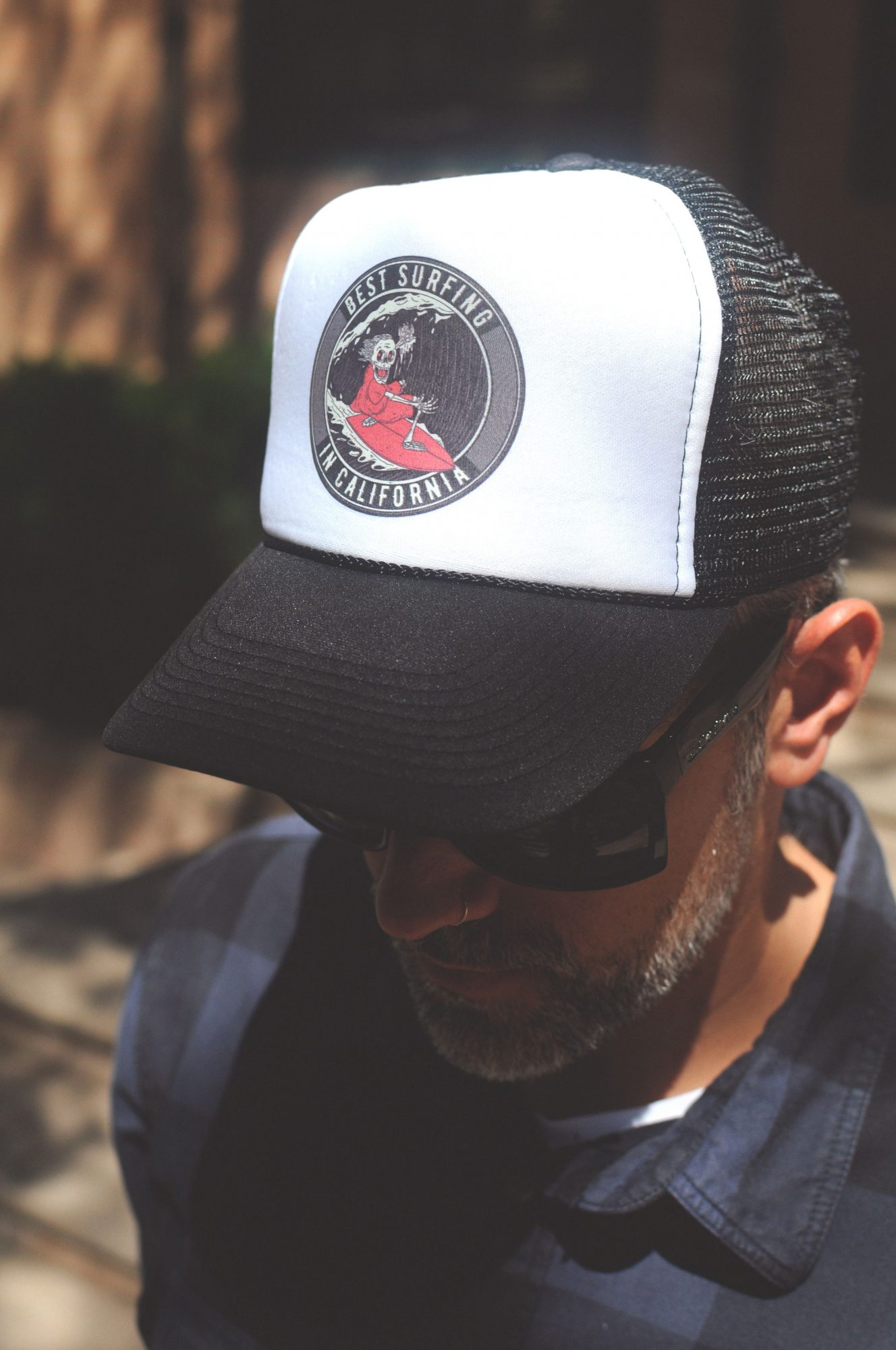man wearing cap mockup logo preview