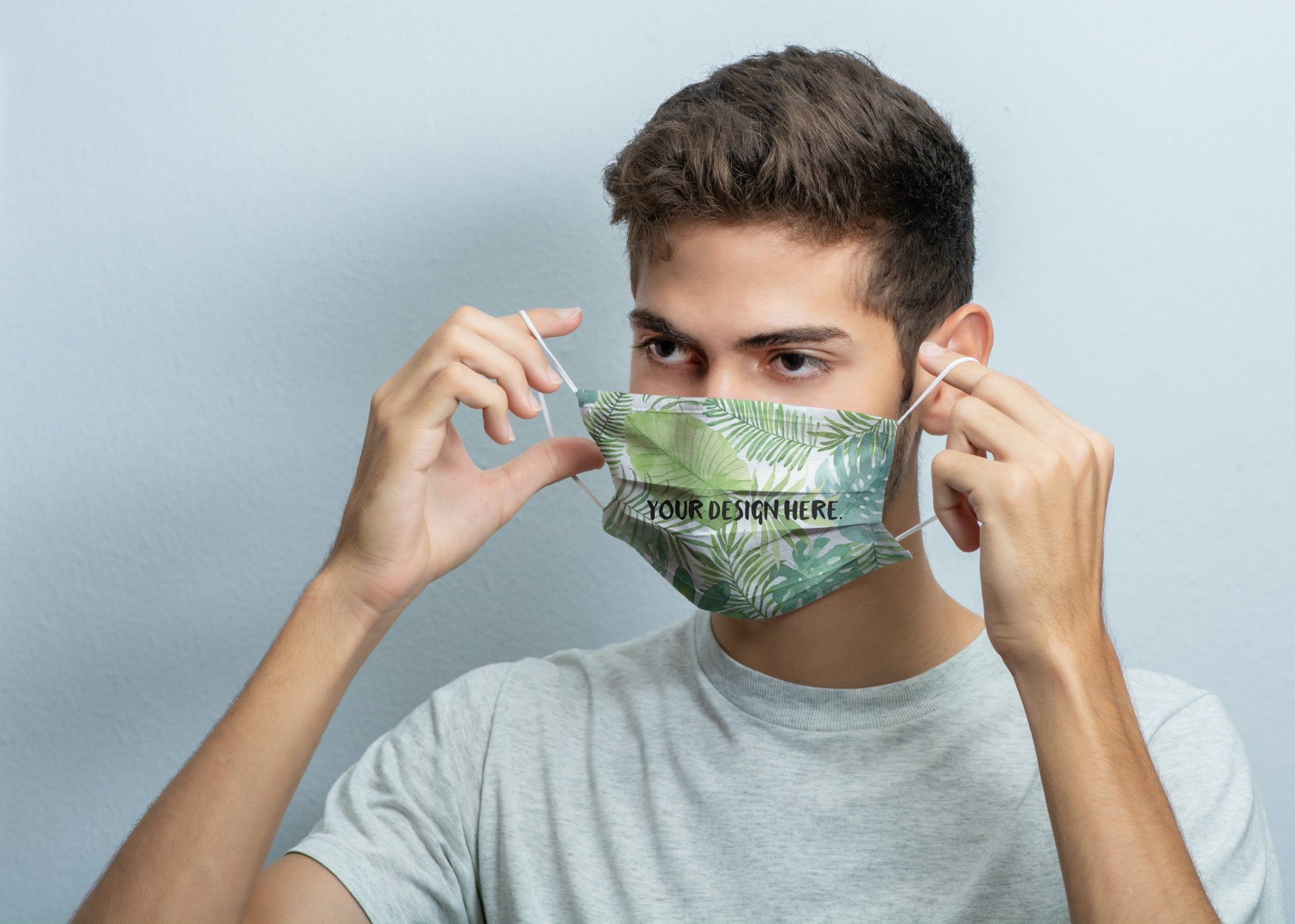 Guy Putting on a Face Mask Mockup