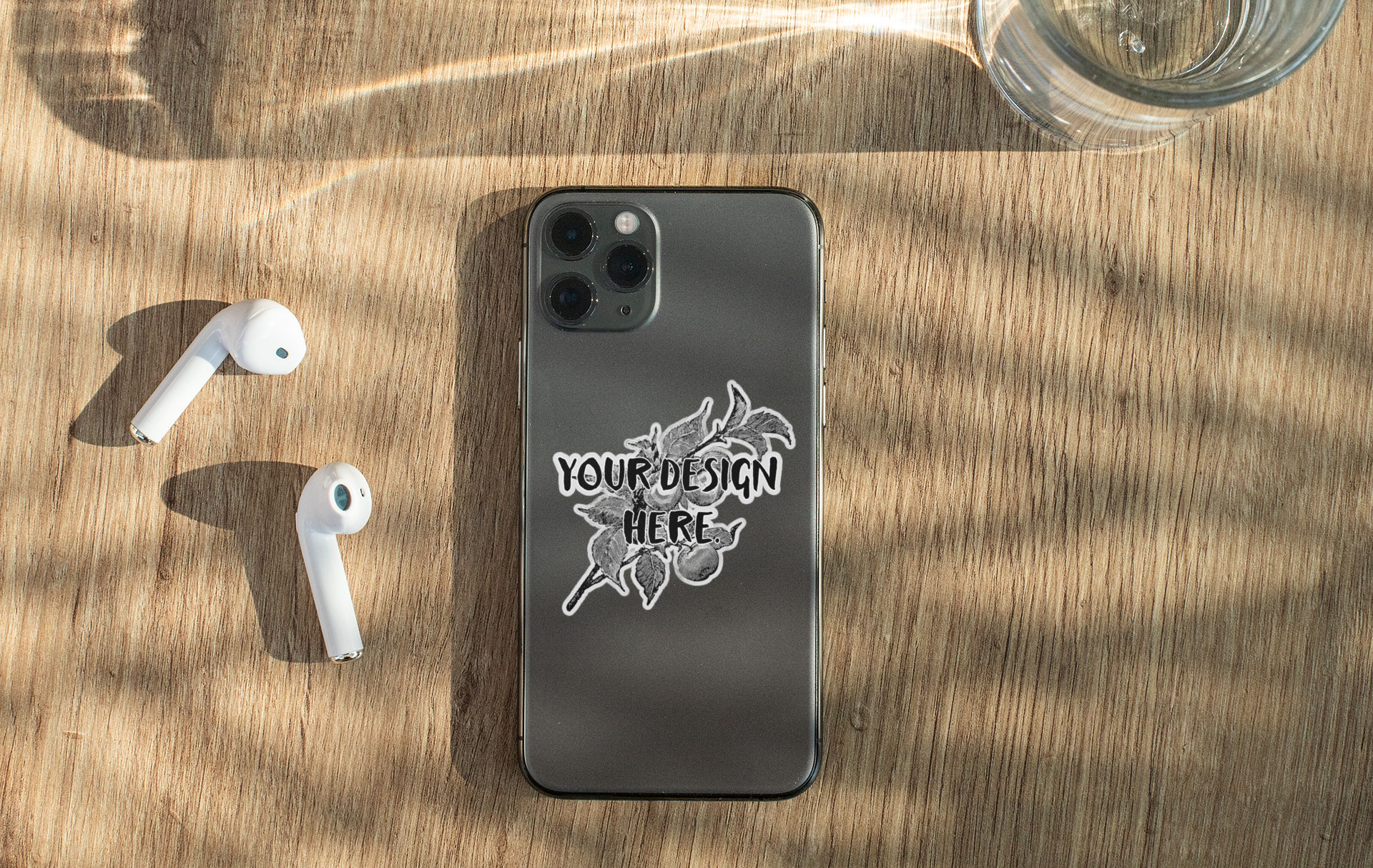Sticker Mockup Featuring a Phone and Headphones